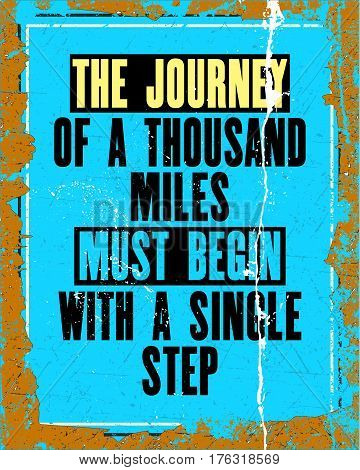 Inspiring motivation quote with text the journey of a thousand miles must begin with a single step. Vector typography poster design concept. Distressed old metal sign texture.