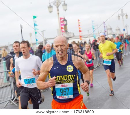 BRIGHTON GREAT BRITAIN - FEB 26 2017: Senior man and competitors running in the Vitality Brighton half marathon competition. February 26 2017 in Brighton Great Britain