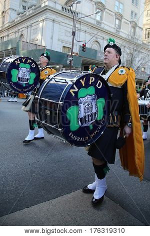 NEW YORK - MARCH 17, 2016: NYPD Emerald Society Band marching at the St. Patrick's Day Parade in New York.