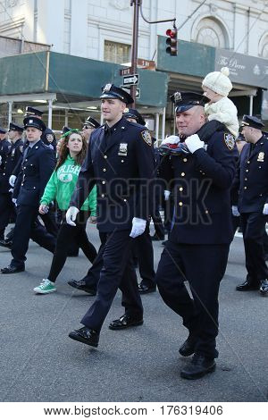 NEW YORK - MARCH 17, 2016: New York Police Department officers marching at the St. Patrick's Day Parade in New York.