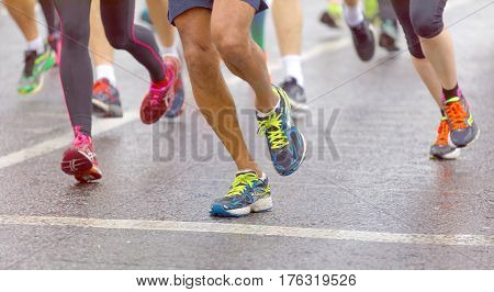 BRIGHTON GREAT BRITAIN - FEB 26 2017: Group of colorful running feet and legs some out of focus in the Vitality Brighton half marathon competition. February 26 2017 in Brighton Great Britain