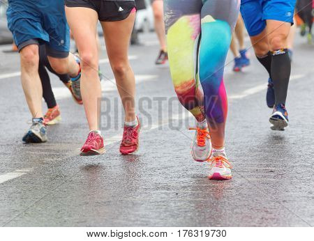 BRIGHTON GREAT BRITAIN - FEB 26 2017: Closeup of colorful running feet and legs in the Vitality Brighton half marathon competition. February 26 2017 in Brighton Great Britain