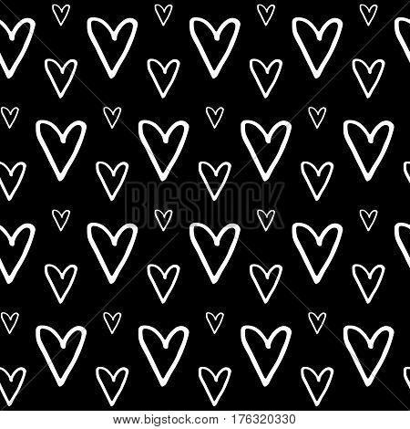 Abstract doodle pattern with hand drawn hearts. Cute vector black and white doodle pattern. Seamless monochrome doodle pattern for fabric, wallpapers, wrapping paper, cards and web backgrounds.