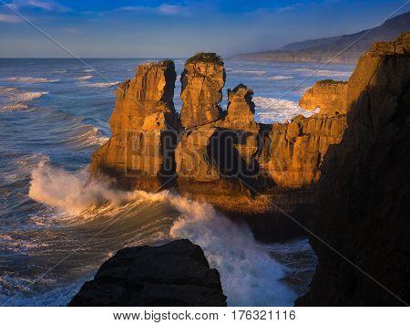 Punakaiki coastal rock formations at sunset in New Zealand