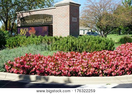 JOLIET, ILLINOIS / UNITED STATES - SEPTEMBER 20, 2016: The sign at the entrance to the Wesmere Country Club Clubhouse shows the temperature to be 86 degrees Fahrenheit.