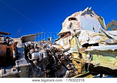 Fighter jet airplane wreck view with blue sky background