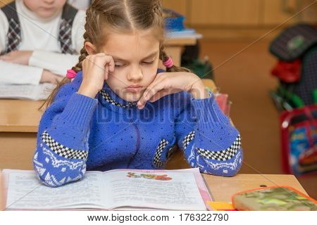 First Grader Girl Feels Bad In The Classroom At School