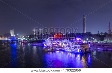 Cairo Egypt - March 9 2017: The Island of Zamalek in central Cairo at night with it's famous boat restaurants on the Nile river.