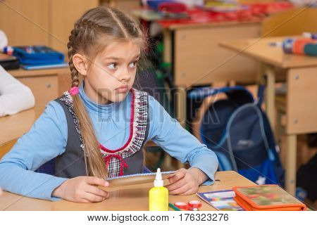 Girl In School To The Labor Class Has Not Understood The Task And With A Puzzled Looking At Teacher