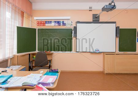 Anapa, Russia - February 28, 2017: A view of the teacher's desk and blackboard in elementary school classroom