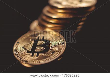 Golden Bitcoins. New virtual money. Bitcoin cryptocurrency.