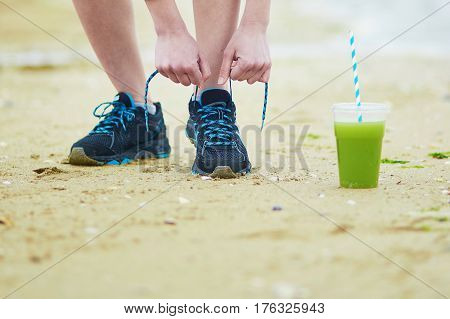Jogger With Green Vegetable Smoothie, Tying Sport Running Shoes Laces