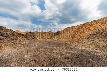 Large heaps of woodchips on an outdoor place