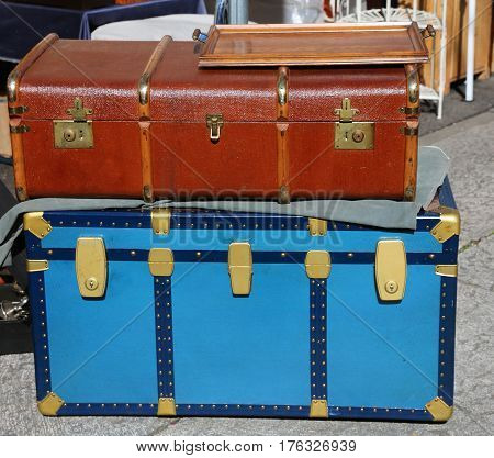 Large trunk luggage and a suitcase in leather ancient travelers
