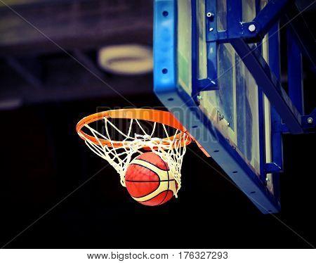 Great Shooting And Basketball Going Into The Basket
