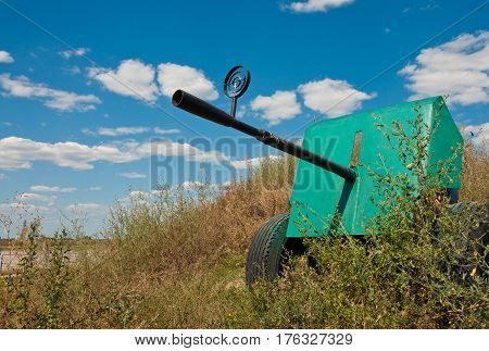 Anti-aircraft gun 1940 in green grass on blue sky background. Weapons of the Red Army during the Second World War