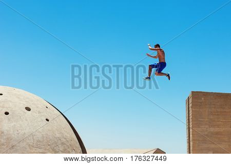 risky man jumping, in little motion blur