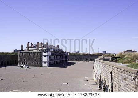 Halifax, Nova Scotia, September 23, 2015 -- Wide view of the central building and people walking on the grounds of the citadel at Halifax, Nova Scotia on a bright sunny day in September