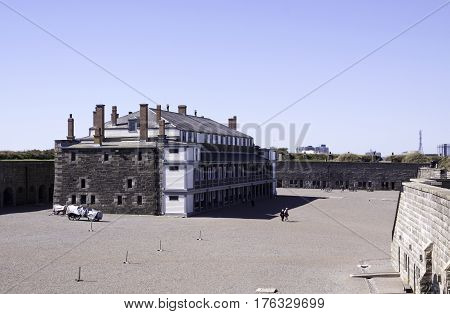 Halifax, Nova Scotia, September 23, 2015 -- Wide view of the central building and people walking on the grounds of the citadel at Halifax Nova Scotia on a bright sunny day in September