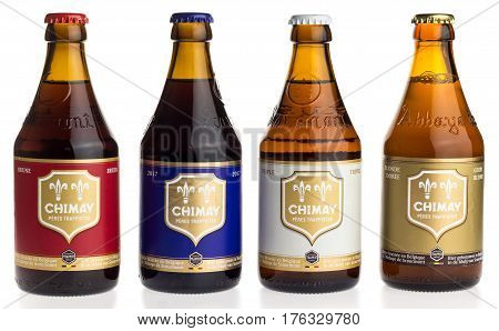 GRONINGEN, NETHERLANDS - MARCH 14, 2017: Bottles of Chimay Blue, White, Blonde and Red beer isolated on a white background