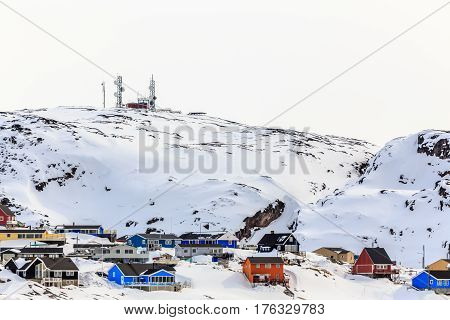 Snow Hill With Inuit Houses And Antennas On The Top, Ilulissat City Greenland