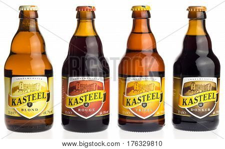 GRONINGEN, NETHERLANDS - MARCH 14, 2017: Bottle of Belgian Kasteel Tripel, Donker, Blonde and Red beer isolated on a white background