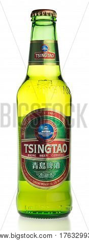 GRONINGEN, NETHERLANDS - MARCH 14, 2017: Bottle of Chinese Tsingtao Lager beer isolated on a white background