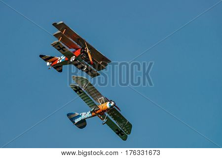 RHINEBECK NY - SEPTEMBER 25 2016: The Aerodrome Air Show Team perform a show with the World War I plane Albatros D.Va (Reproduction) Fokker Dr-I at Old Rhinebeck Aerodrome