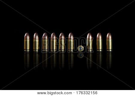 Ammo on a black background. 9 mm
