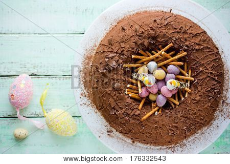 Chocolate Easter egg nest cake Easter food concept background