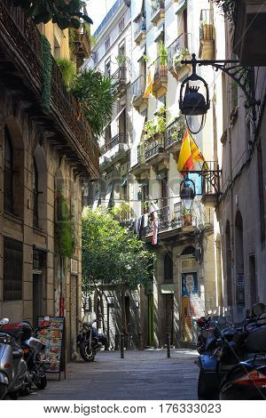 BARCELONA, SPAIN - March 10 2017: View looking down a narrow street in the Gothic Quarter Old Town of Barcelona Spain