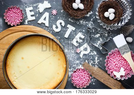 Easter baking background preparation for Easter holiday cooking Easter cake traditional Easter decorations on kitchen table top view