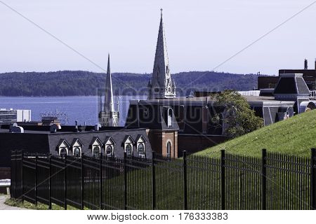 A wide view of buildings and church spires overlooking the Halifax Harbor in Halifax Nova Scotia on a bright sunny day in September