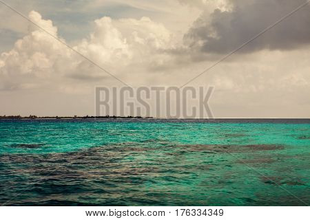 summer sea with blue water wave. Outdoor tropical summer sea paradise. Heaven view of deep transparent ocean. Sunshine reflection on a calm summer ocean. Tranquility of turquoise water