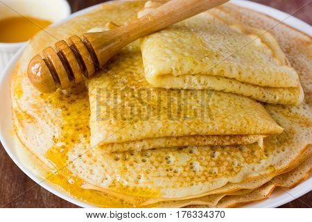 Traditional yeast pancakes with honey Russian cuisine. Shrove Tuesday