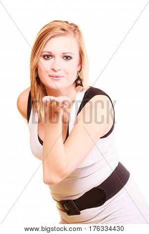 Gesture flirt coquet concept. Beautiful blonde woman sending air kiss. Studio shot isolated.