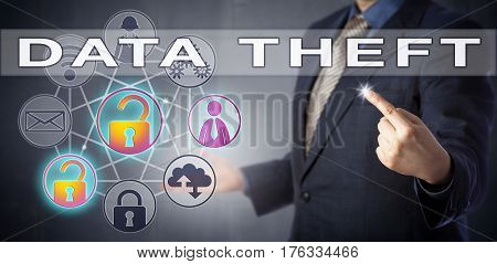 System administrator in blue shirt and suit is identifying a DATA THEFT. Computer crime concept and data security metaphor for unauthorized copying of proprietary data and abusing trusted access.