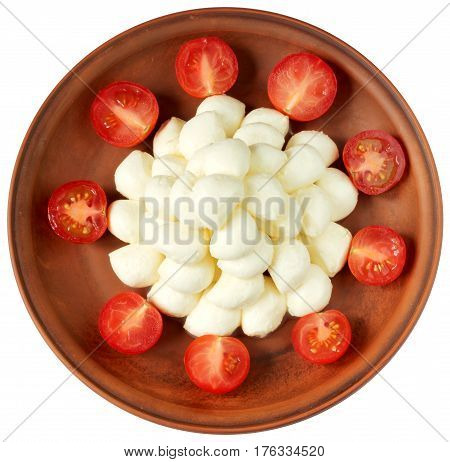 Baby mozzarella and cherry tomatoes on plate isolated on white background