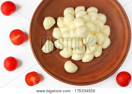 Mozzarella cheese and red cherry tomatoes on a white background