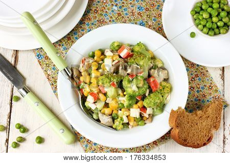 Vitamin salad with fresh vegetables: broccoli green peas and corn