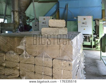 Compressed sawdust briquettes for heating in the package in the premises of the production plant