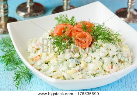 Holiday salad with salted salmon cucumber dill mayonnaise close up
