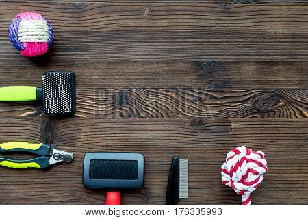 Pet accessory and care set on rustic table background top view mock-up