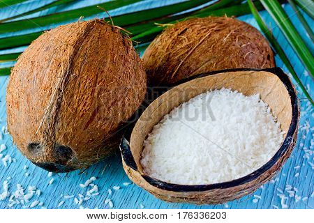 Fresh coconut and coconut chips. Preparation of desiccated coconut at home the use and application of coconut. Selective focus