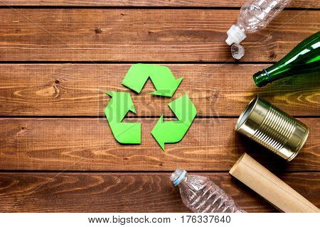 waste recycling eco symbol with garbage disposal on wooden table background top view mockup