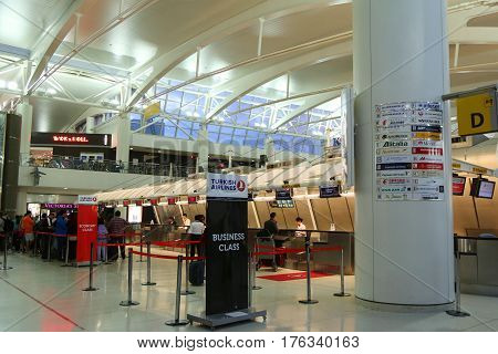 NEW YORK - MAY 22, 2015: Inside of Terminal 1 at JFK International Airport in New York. JFK is one of the biggest airports in the world with 4 runways and 8 terminals
