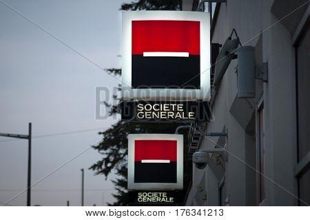 NOVI SAD SERBIA - MARCH 11 2017: Logo of the Societe Generale Srbija Bank illuminated in the evening on a branch Novi Sad Serbia
