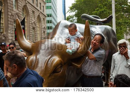 Tourists Visits The Wall Street Charging Bull Statue