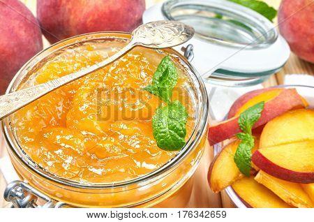 Peach jam in a jar. Homemade fruit jam