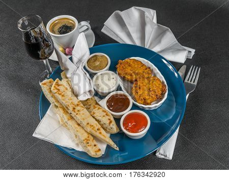 Oriental Indian Set,  Naan Bread And Onion Bhaji, Four Sauces, Blue Plate, Black Coffee, Liqueur